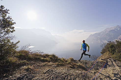 Italy, Mature man jogging by Lake Garda - MIRF000395