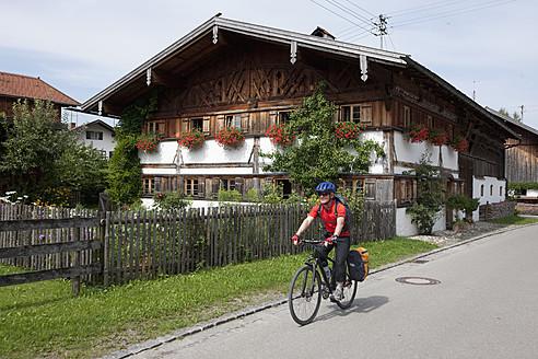 Germany, Bavaria, Mature man riding bicycle - DSF000284