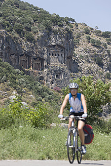 Turkey, Kaunos, Mid adult woman riding bicycle - DSF000362