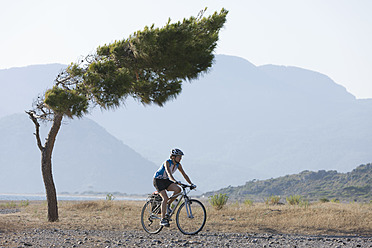 Turkey, Mid adult woman riding bicycle - DSF000368