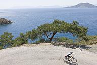 Turkey, Oyuktepe Peninsula, Mid adult woman riding bicycle - DSF000379