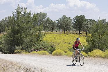 Turkey, Boynuzbuku, Mid adult woman riding bicycle - DSF000350