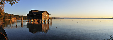 Germany, Bavaria, Stegen, Wooden boathouse in Lake Ammer - ESF000156