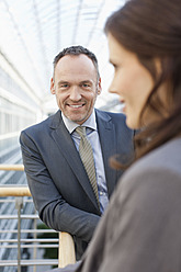 Germany, Leipzig, Business people smiling - WESTF018560