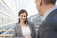 Germany, Leipzig, Business people smiling - WESTF018563