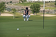 Cyprus, Woman playing golf on golf course - GNF001216