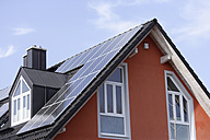 Europe, Germany, Bavaria, Munich, Solar panels on roof - TCF002273