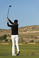 Cyprus, Woman playing golf on golf course - GNF001224