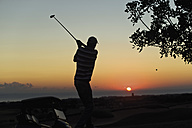 Cyprus, Man playing golf on golf course - GNF001213