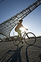 Germany, Bavaria, Munich, Mid adult woman riding bicycle - DSF000483