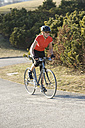 Germany, Bavaria, Munich, Mid adult woman riding bicycle - DSF000480