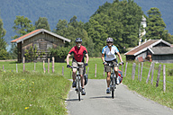Germany, Bavaria, Zwergern, Man and woman riding bicycle - DSF000459