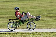Germany, Bavaria, Mature man riding bicycle - DSF000530