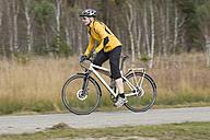 Germany, Bavaria, Mature man riding bicycle - DSF000454