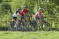 Germany, Bavaria, Man and women riding bicycle - DSF000560