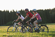 Germany, Bavaria, Man and women riding bicycle - DSF000549