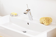 Germany, Bavaria, Bathroom sink with soap and sponge - MAEF004573