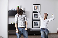 Germany, Bavaria, Young couple playing with game console - MAEF004624