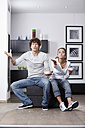 Germany, Bavaria, Young couple watching TV - MAEF004627