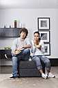 Germany, Bavaria, Young couple watching TV - MAEF004629
