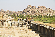 India, Karnataka, View of ancient Vijayanagara ruins of Hampi bazaar - MBEF000294