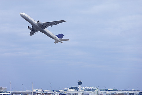 Europe, Germany, Bavaria, Commercial passenger air plane taking off at Munich airport - TCF002346