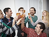Germany, Cologne, Men and women toasting with champagne in office - RHYF000070