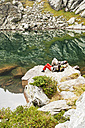 Austria, Styria, Man and woman having rest at Lake Obersee - HHF004084