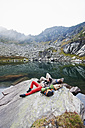 Austria, Styria, Man and woman having rest at Lake Obersee - HHF004092