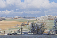 Germany, Saxony, View of wind turbine and rolling landscape - MJF000035