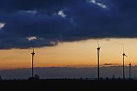 Germany, Saxony, View of wind turbine against cloudy sky - MJF000011