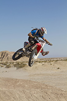 USA, California, Motocrosser jumping on Palm Desert - FFF001276
