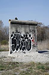 Germany, Berlin, Graffiti on piece of berlin wall - JM000128