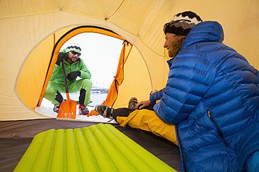 Norway, Lyngen, Skier in tent, smiling - FFF001305