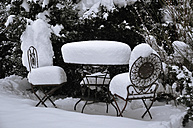 Germany, View of garden table and chair covered with snow - AXF000021