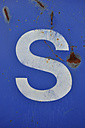 White spray paint letter S on blue, close up - AXF000031