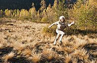 Austria, Salzburg, Young woman running in autumn - HHF004162