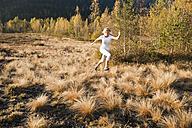 Austria, Salzburg, Young woman running in autumn - HHF004165