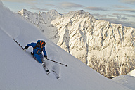 Norway, Mature man skiing on step mountain - FFF001310