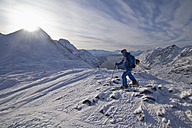 Norway, Skier walking in snow with pole - FFF001311
