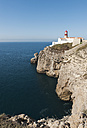 Portugal, Algarve, Sagres, Lighthouse on cliff at Atlantic ocean - MIRF000399