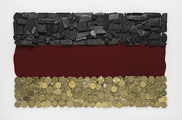 German flag created by coal, blood and coin on white background - MUF001204