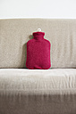 Germany, Hot water bottle on sofa - MUF001216