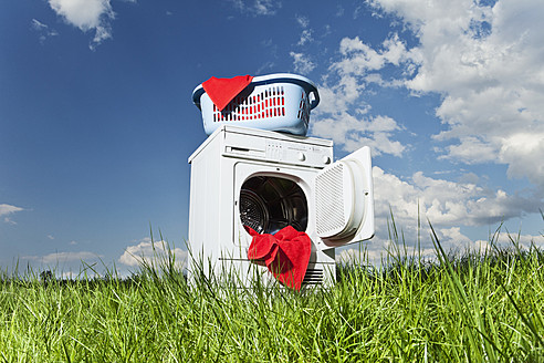 Germany, Bavaria, laundry dryer in grass - MAEF004688