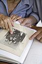 Germany, Bavaria, Senior couple with photo album - TCF002571