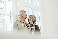 Germany, Berlin, Senior couple looking at each other, smiling - FMKYF000034