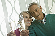 Germany, Berlin, Senior couple drinking champagne - FMKYF000058