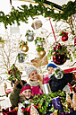 Austria, Salzburg, Mother with children at christmas market, smiling - HHF004199