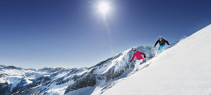Austria, Salzburg, Young couple skiing on mountain - HHF004184