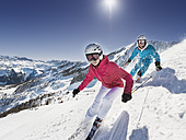 Austria, Salzburg, Young couple skiing on mountain - HHF004186
